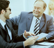 The image of business partners discussing documents and discussing with each other Royalty Free Stock Image