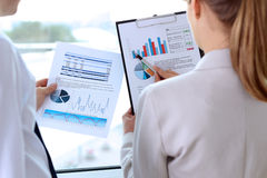 Image of business partners discussing documents, graphs at meeti Stock Photos