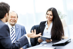 Image of business partners discussing documents and ideas at mee Stock Image