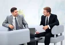 Image of business partners discussing documents and ideas at mee Stock Images