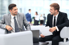 Image of business partners discussing documents and ideas at mee Royalty Free Stock Images