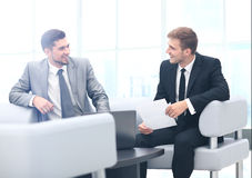 Image of business partners discussing documents and ideas at mee Stock Photo