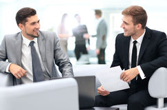 Image of business partners discussing documents and ideas at mee Stock Photography