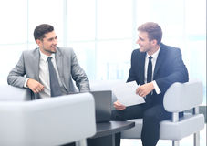 Image of business partners discussing documents and ideas at mee Royalty Free Stock Photography