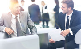 Image of business partners discussing documents and ideas at mee Royalty Free Stock Image