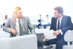 Image of business partners discussing documents and ideas at mee Stock Photos