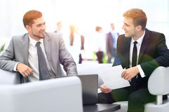 Image of business partners discussing documents and ideas at mee Royalty Free Stock Photos