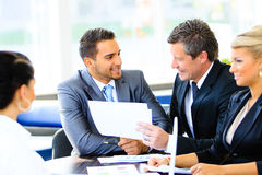 Image of business partners discussing Stock Photography