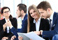 Image of business partners discussing documents and ideas Royalty Free Stock Image