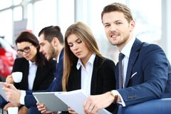 Image of business partners discussing documents and ideas Royalty Free Stock Photos