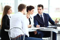 Image of business partners discussing documents and ideas. At meeting Royalty Free Stock Photography
