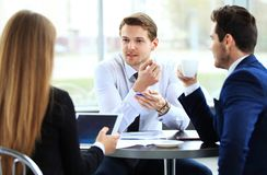 Image of business partners discussing documents and ideas. At meeting Royalty Free Stock Photo