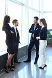 Image of business partners discussing documents and ideas Stock Photo
