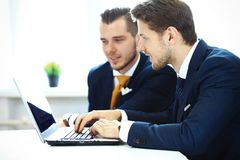 Image of business partners discussing documents and ideas Royalty Free Stock Photography
