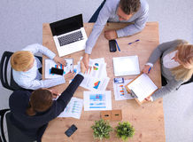 Image of business partners discussing documents. And ideas at meeting royalty free stock photo