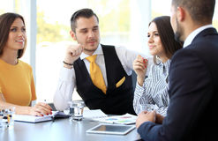Image of business partners discussing documents and ideas. At meeting Royalty Free Stock Images