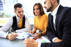 Image of business partners discussing documents and ideas Stock Photography
