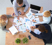 Image of business partners discussing documents and ideas at meeting stock images