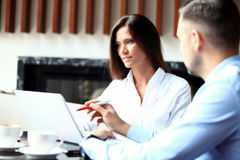 Business partners discussing documents and ideas at meeting Royalty Free Stock Images