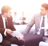 Business people Having Meeting Around Table In Modern Office. Image of business partners discussing documents and ideas at meeting Royalty Free Stock Image