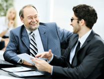 The image of business partners discussing documents and ideas the office Stock Photography