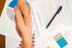 Image of business partners handshaking Stock Images