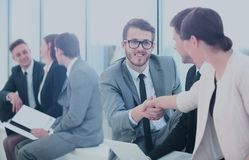 Business People Meeting Discussion Corporate Handshake Concept. Image of business partners handshaking after signing contract Royalty Free Stock Images