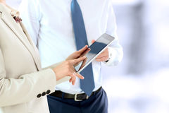 Image of business partners using digital tablet at meeting Royalty Free Stock Photography