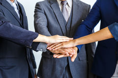 Image of business people joining hands together, success and tea. M work concept Stock Photo