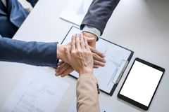 Image of business people joining and putting hands together during their meeting, connection and collaboration concept, Teamwork stock images
