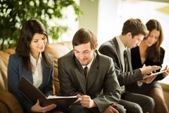 Image of business people listening and talking to their colleague Royalty Free Stock Photography