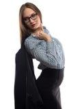 Image of business woman holding black jacket Stock Photo