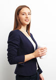 Image of business woman holding coffee cup over white Stock Photography