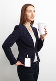 Image of business woman holding coffee cup over white Stock Images