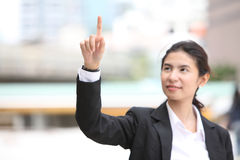 Image Business woman writing whatever you want with her finger. Business woman writing whatever you want with finger stock images