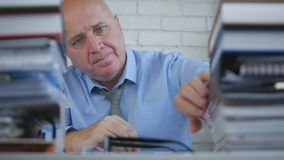Businessman In Accounting Archive Searching in Documents And Invoices stock images