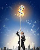 Image of businessman climbing rope. Attached to pound sign Stock Images