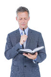 image of businessman with diary Royalty Free Stock Image