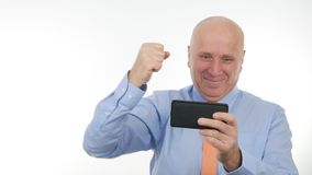 Businessman Gesticulate Happy Reading Financial Good News on Mobile. Image with Businessman Gesticulate Happy Reading Financial Good News on Mobile stock photography