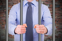Businessman in jail. Royalty Free Stock Photography