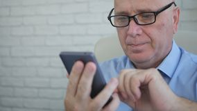 Businessman in Office Text Using Cellphone Wireless Network stock photos