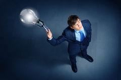 Image of businessman top view. Top view of young businessman making decision Stock Image