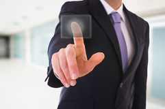 Businessman touching button. Royalty Free Stock Photography