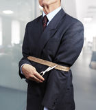 Image of businessman trying to get rid of fetters. In office Stock Image