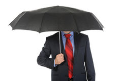 Image of a businessman with umbrella Stock Photo