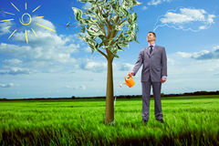 Image of businessman watering money tree Stock Image