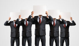 Image of a businessmen standing in a row Stock Images