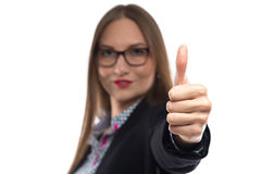 Image of businesswoman in glasses showing thumb Royalty Free Stock Photography