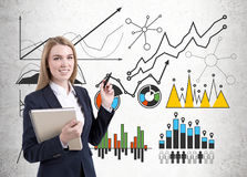 Image of businesswoman in grey suit drawing graph Royalty Free Stock Photography