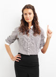 Image of businesswoman pointing with her finger up to empty copy Stock Image